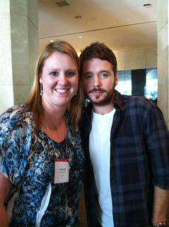 Dr. Joel Schlessinger's staff member, Ashley Bell, gets a photo taken with Kevin Connolly from Entourage