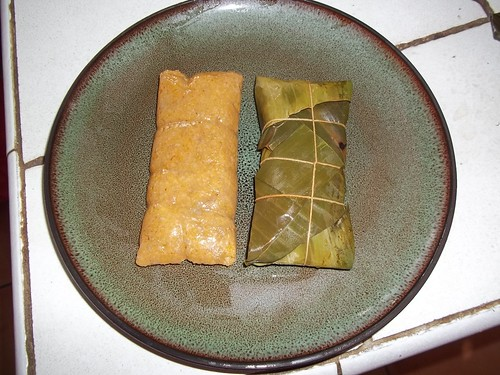 A photo of pasteles, which are made from ground banana stuffed with meat or chicken, wrapped in a banana leaf and cooked.  These were prepared using bananas donated from the research station.