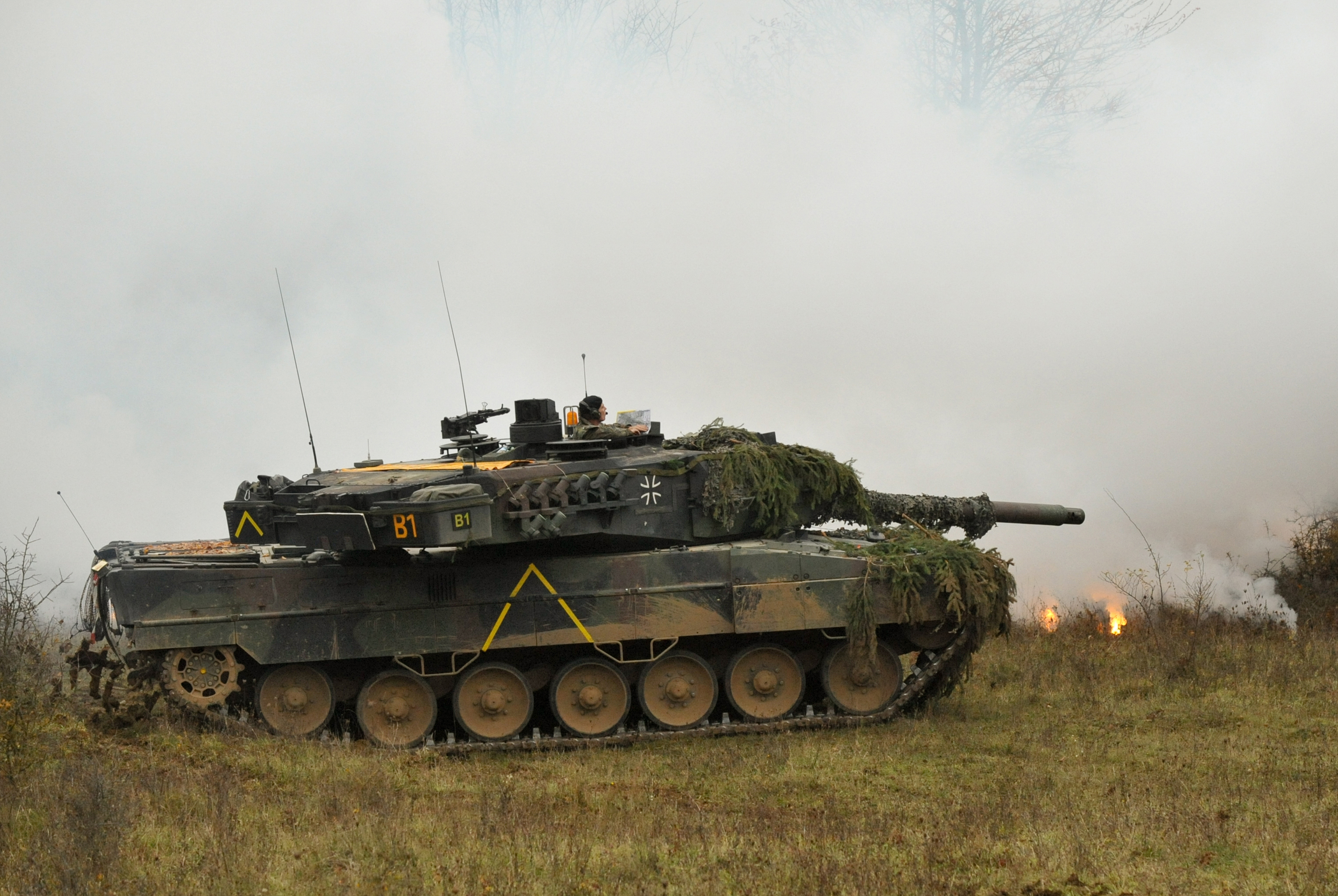 A German Army Leopard II tank, assigned to 104th Panzer Battalion, lays down a cover of white smoke during Saber Junction 2012