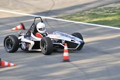 auto racing(0.0), formula racing(0.0), indycar series(0.0), formula one(0.0), sports car(0.0), automobile(1.0), kart racing(1.0), racing(1.0), sport venue(1.0), vehicle(1.0), sports(1.0), performance car(1.0), race(1.0), automotive design(1.0), open-wheel car(1.0), motorsport(1.0), formula one car(1.0), race track(1.0),