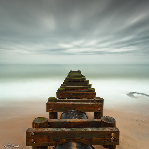 wood longexposure sea orange brown white green water clouds square sand surf steel shoreline lee delaware groyne atlanticocean 1740l traininvain 5dii bigstopper jpbenante
