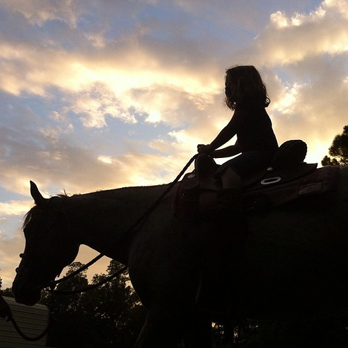 A girl on a horse. My girl. #silhouette #countryliving #nofilter