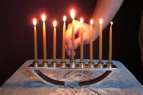 menorah burning with hand.jpg