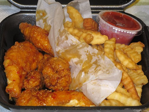 Sweet chili boneless wings and fries by Coyoty