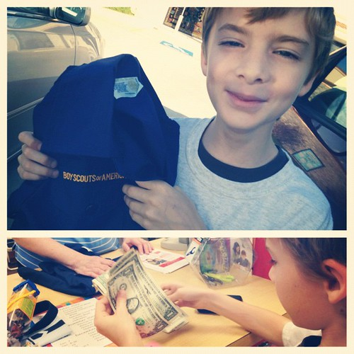 Vincent, excited about his purchase, a Cub Scout shirt!