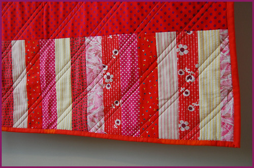 hot hued HST baby quilt, back