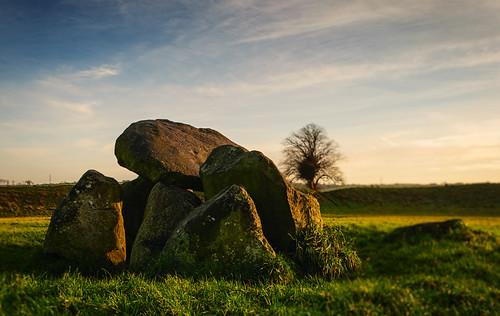 sunset sunlight megalithic monument stone giant ancient standingstones dusk stones bank belfast burial lichen aged stoneage henge giantsring alienskin