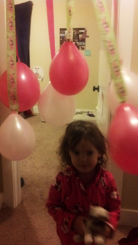 Running through her birthday balloons