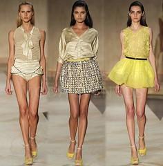 clothing(1.0), yellow(1.0), runway(1.0), fashion(1.0), fashion design(1.0), fashion show(1.0), fashion model(1.0), dress(1.0),