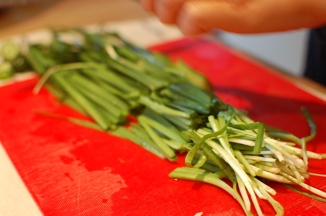 Making cucumber and chives kim chi