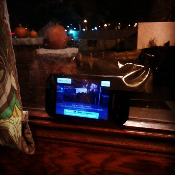 @jake_nerdnest taped an old phone to our door & is using it to live stream trick-or-treaters to our TV (we don't have a doorbell).