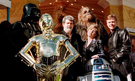 George Lucas posing with cast member of Star Wars in Los Angeles