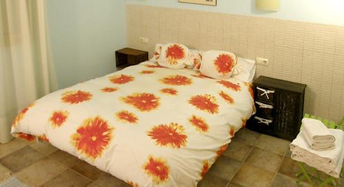 Habitació triple amb llit per a dos persones