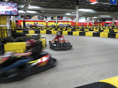 race car(0.0), auto racing(0.0), stock car racing(0.0), open-wheel car(0.0), formula racing(0.0), dirt track racing(0.0), pit stop(0.0), formula one(0.0), formula one car(0.0), supercar(0.0), go-kart(1.0), kart racing(1.0), racing(1.0), sport venue(1.0), vehicle(1.0), sports(1.0), race(1.0), motorsport(1.0), race track(1.0),