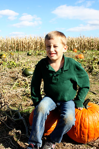Nathan-sitting-on-two-pumpkins