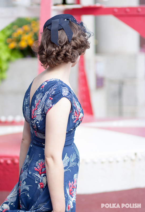 Ribbons at the back of this navy blue 1940s tilt hat are a fun finishing touch