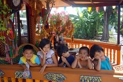 children at a buddhist shrine