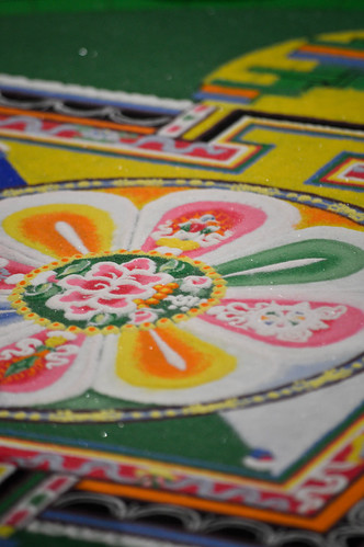 Sand mandala made of tiny grains of sand.