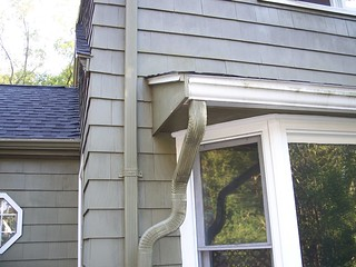 Gutter system directed to rain barrels