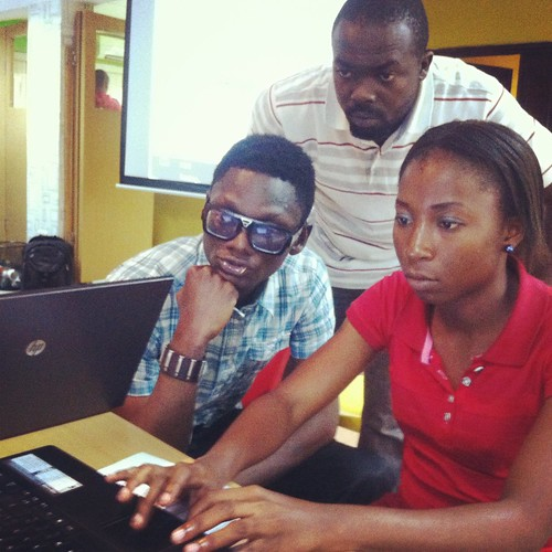 Three young Nigerians working on a way to simplify and visualize technical, complicated information to be more easily understood by the general population
