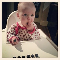 This child will shove as many blueberries in her gob as you want to give her.
