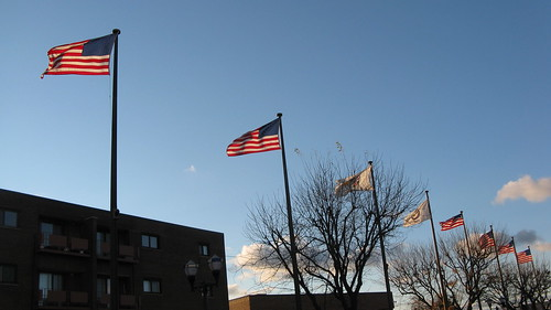 Late day sunshine and backlit flags.  Elmwood Park Illinois.  Late October 2012. by Eddie from Chicago