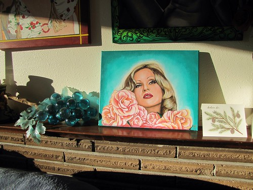 Candy Darling painting on the mantel