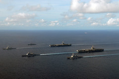 Ships of the George Washington and John C. Stennis Carrier Strike Groups steam together in the Andaman Sea, Oct. 12. (U.S. Navy photo by Chief Mass Communication Specialist Jennifer A. Villalovos)