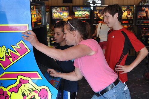 Julie demonstrates her Ms. Pac-Man prowess
