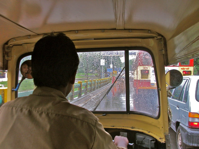 Rickshaw driver in Pune, India on a rainy day