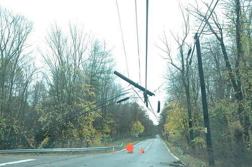Utility pole dangles from power lines by Jai Agnish
