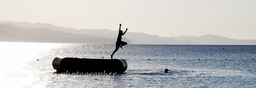 blue sea vacation sky copyright holiday tourism beach water swimming seaside jumping photographer turquoise restful peaceful tranquility diving trampoline jamaica caribbean raft tranquil montegobay doctorscove alisontoon