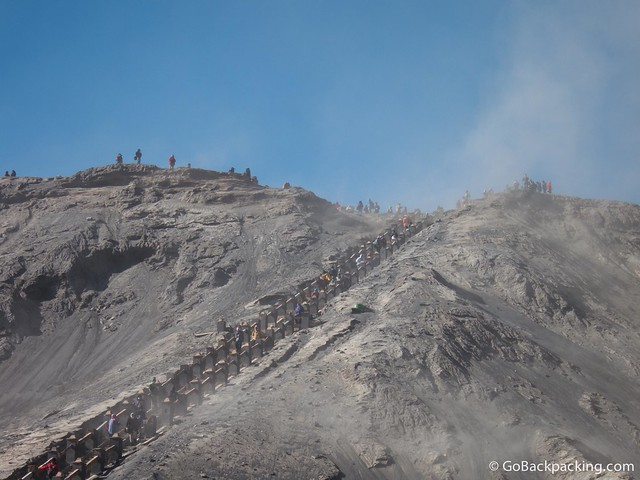 Wind-swept ash clouds the final staircase to the crater
