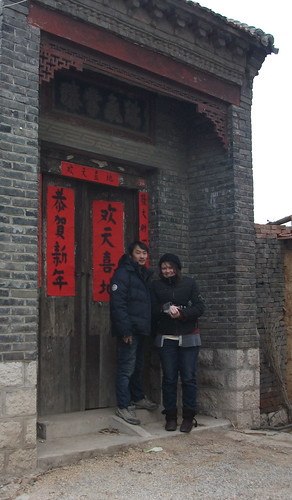 An Australian girl and her Chinese boyfriend, standing on a historical street in China