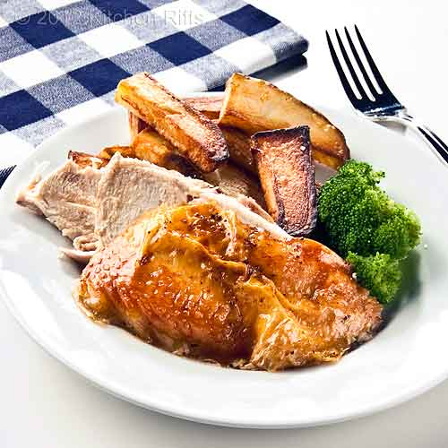 Roast Chicken on Plate with Broccoli and Roast Potatoes