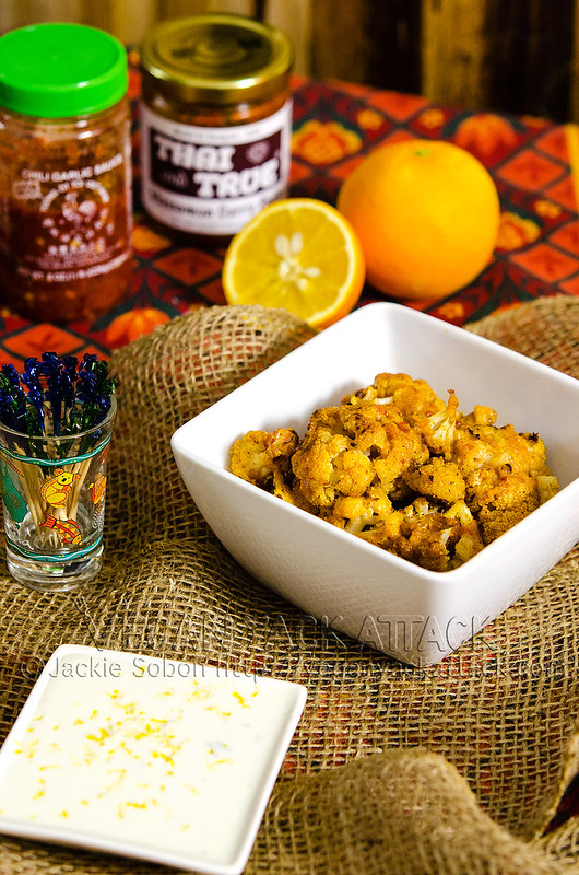 This in an intensely flavorful appetizer of baked Thai Curry Cauliflower Bites with a creamy coconut lime aioli. Allergy-friendly, pretty healthy, and VERY tasty! #vegan #vegetarian #appetizer #thai #cauliflower