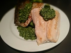 Homemade pan-fried salmon steak with coriander pes…