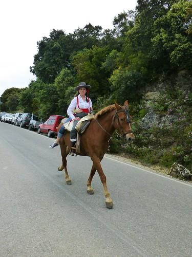 Romeria in Pruna: flamenco lady on horseback