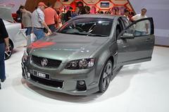 automobile(1.0), automotive exterior(1.0), exhibition(1.0), family car(1.0), wheel(1.0), vehicle(1.0), automotive design(1.0), auto show(1.0), compact car(1.0), bumper(1.0), pontiac g8(1.0), sedan(1.0), land vehicle(1.0), luxury vehicle(1.0), sports car(1.0),