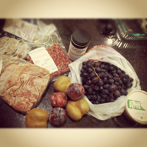 Farmer's market bounty: CA-raised grass-fed/finished meat, grapes, pluots, kiwi, almond butter, & chamomile mint tea for Gigi. Score! (