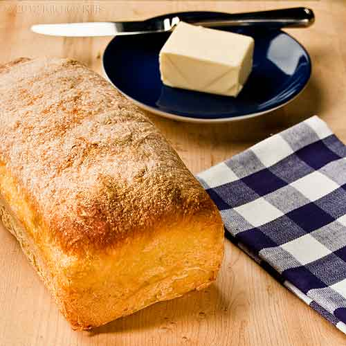 Easy No-Knead Homemade Bread in Loaf Shape, with Butter and Napkin
