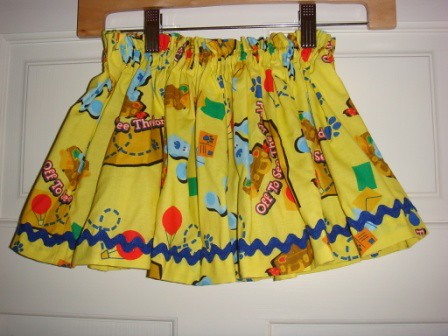 Yellow print skirt with blue rick rack
