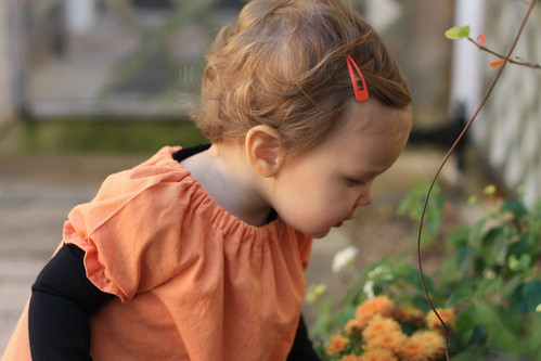 sweet girl smelling the flowers