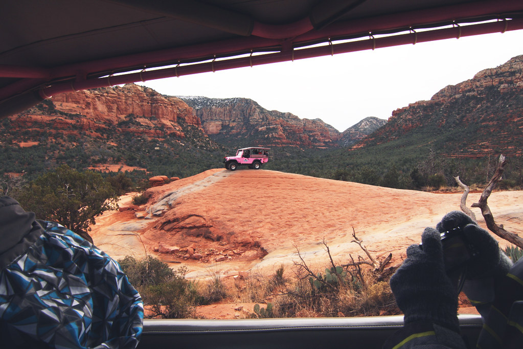 pink jeep on rock