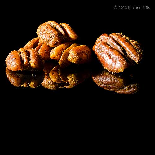 Spiced Roasted Pecans on Black Acrylic
