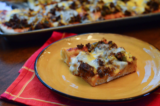 A slice of Cheeseburger Pan Pizza.