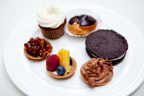 All desserts round: Various mini tarts, Homemade Oreo cookie, mini vanilla cream puff, mini banana cupcake
