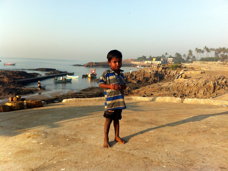 Kid enjoying the sun near Madh fort