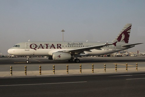 Qatar Airways A320 rego A7-AHE taxis past the access road at Doha