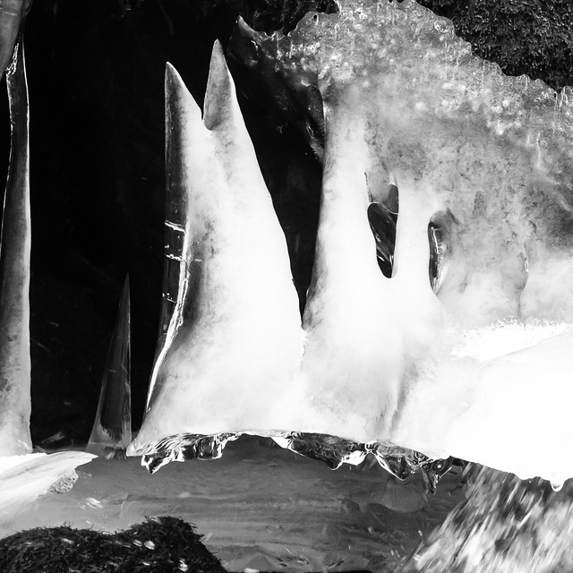 Ice stalagmites under waterfall